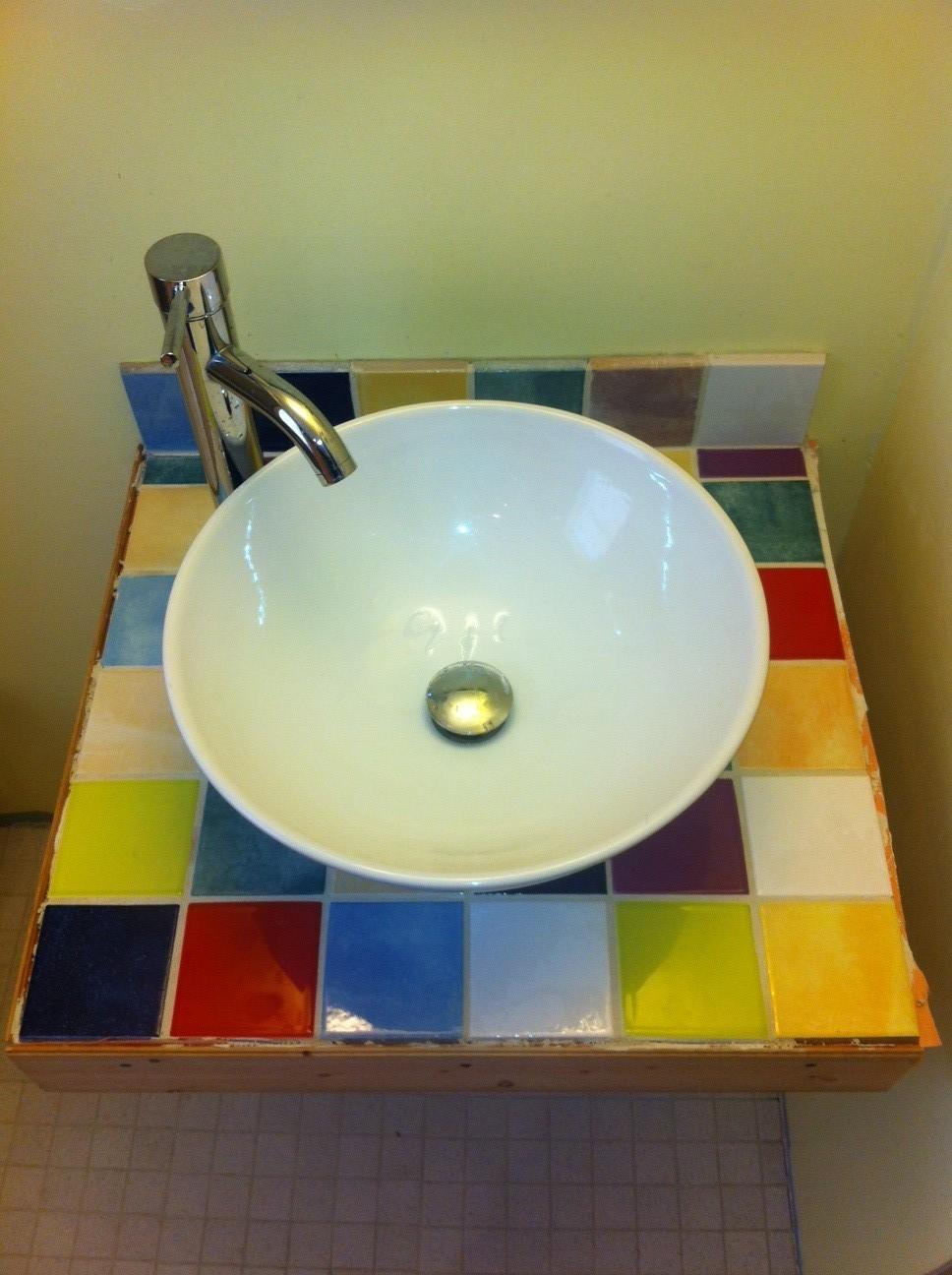 Siri's fun tile work under the (new) bathroom sink.